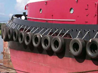 a picture of bumper tires on a red ship