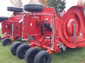 a picture of a red mower deck with tires